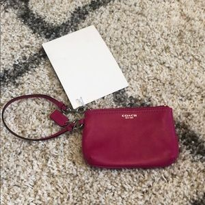 NEW COACH Dark pink wristlet.